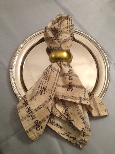 There's also this gold napkin ring holder, showing a different way to display the napkin.