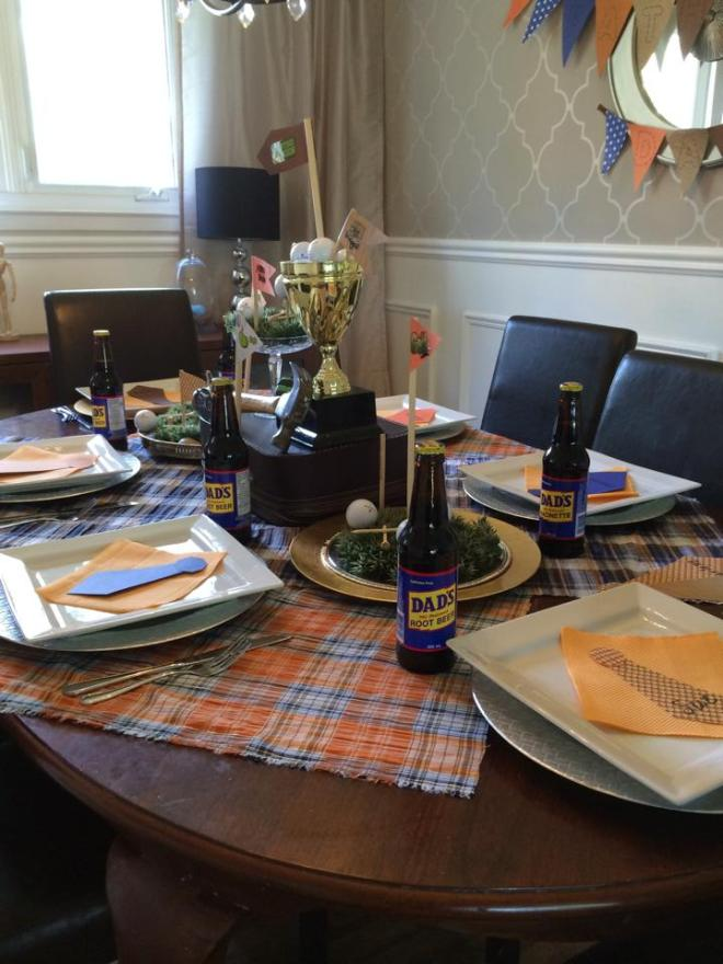 Father's Day Tablescape. This fun table was put together using plaid fabric, golf balls and tools from around the house as a tirbute to dad. apurdylittlehouse.com